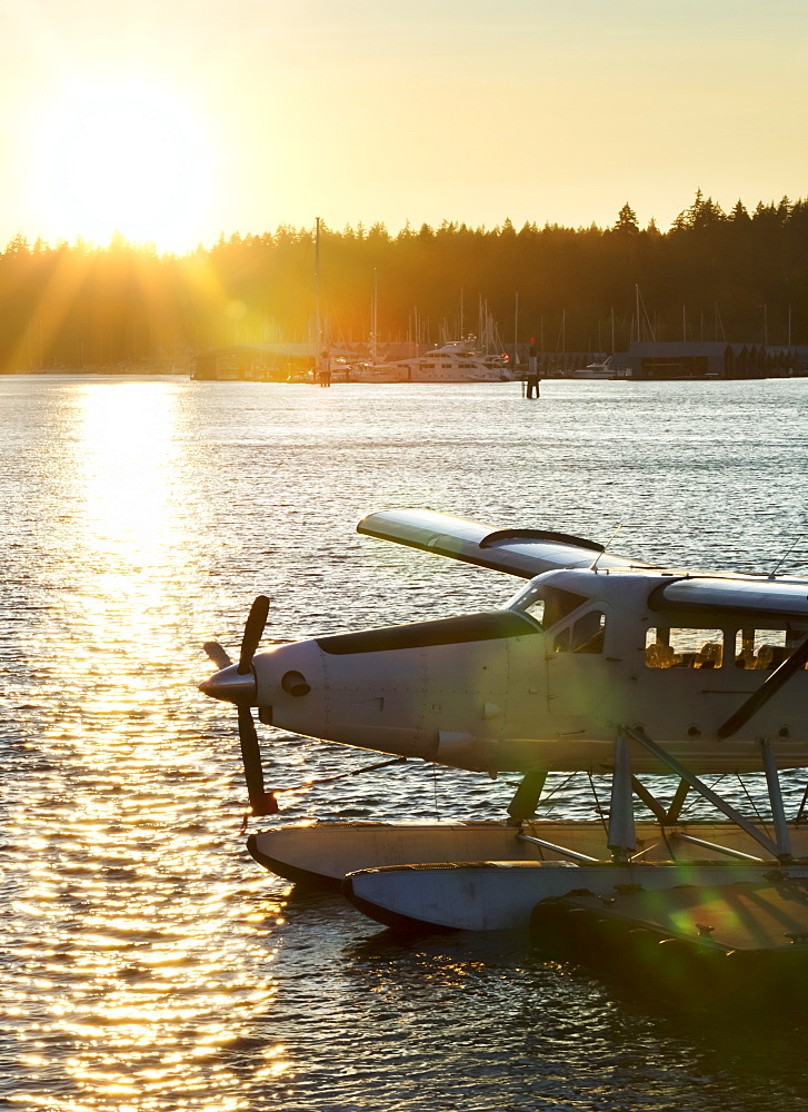 Floatplane along a dock a sunset, Vancouver, British Columbia, Canada