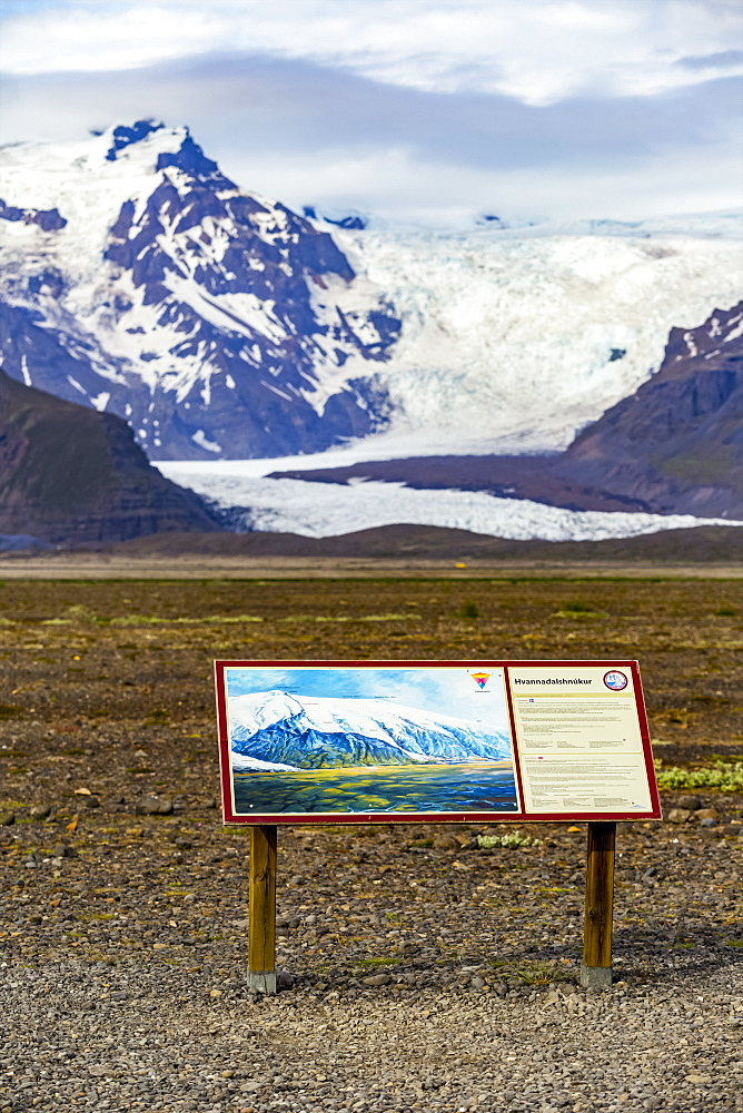 A tourism sign at this Iceland viewpoint describes Hvannadalshnjukur peak on the northwestern rim of the crater of the Oraefajokull volcano in Iceland and is the highest in Iceland, Iceland