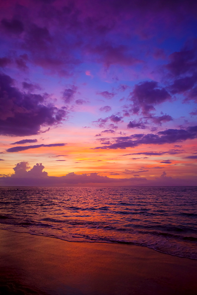 Sunset colours lighting oup clouds and ocean, Wailea, Maui, Hawaii, United States of America