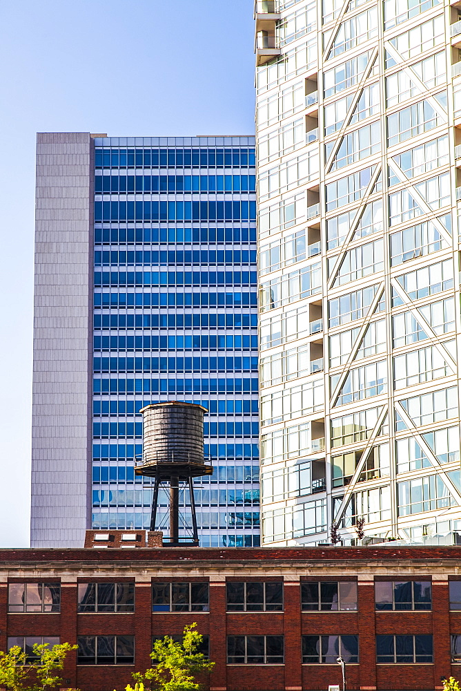 Buildings in downtown Chicago with a water reservoir on the rooftop of a residential building, showing the contrast of old and new buildings, Chicago, Illinois, United States of America