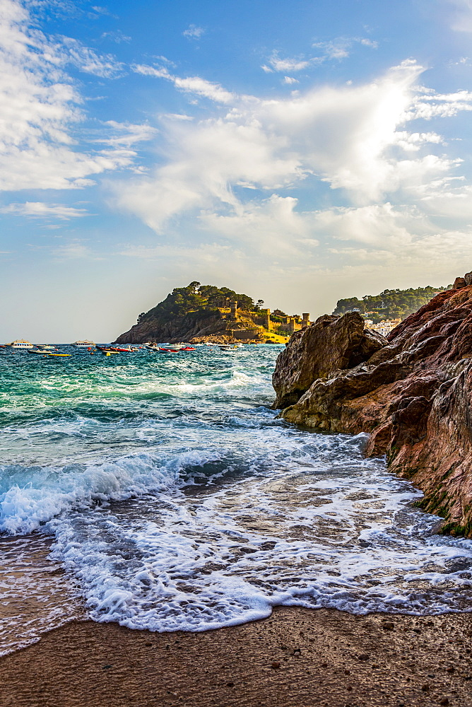 Beach view from Tossa de Mar of Castell de Tossa, which was built in 1187, Tossa de Mar, Girona, Spain