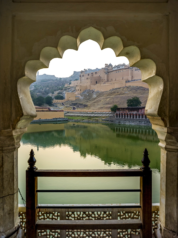 Maota Lake in front of Amer Fort viewed through a scalloped archway, Jaipur, Rajasthan, India
