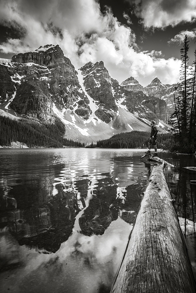 Rugged peaks of the Rocky Mountains reflected in a lake in Banff National Park, Alberta, Canada