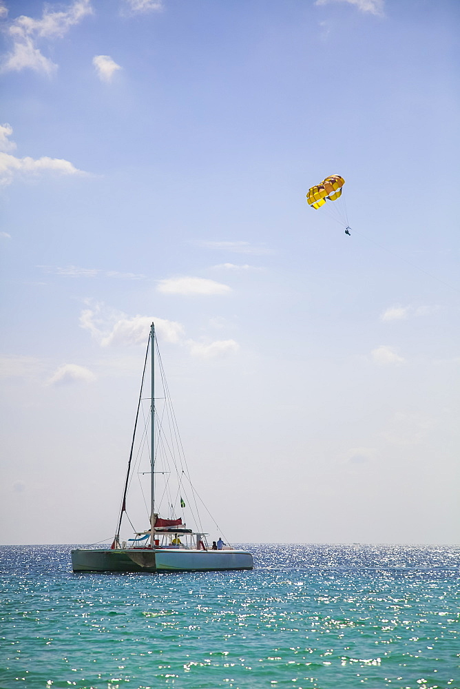 Large catamaran and parasailer on open tropical water, Negril, Jamaica