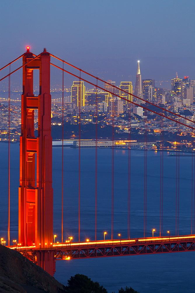 The Golden Gate Bridge and San Francisco skyline at night, San Francisco, California, United States of America, North America