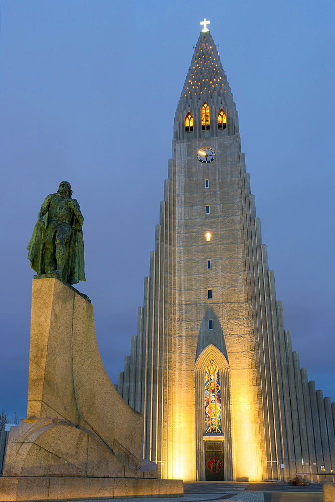 The Hallgrims Church with a statue of Leif Erikson in the foreground lit up at night, Reykjavik, Iceland, Polar Regions - 1132-281