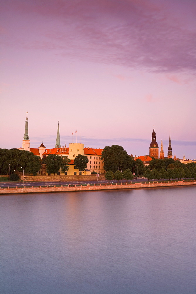 Riga Castle and the River Daugava illuminated at sunset, Riga, Latvia, Europe