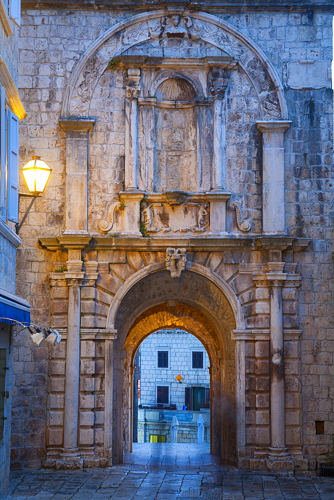 Land Gate illuminated at dusk, Stari Grad (Old Town), Korcula Town, Korcula, Dalmatia, Croatia, Europe