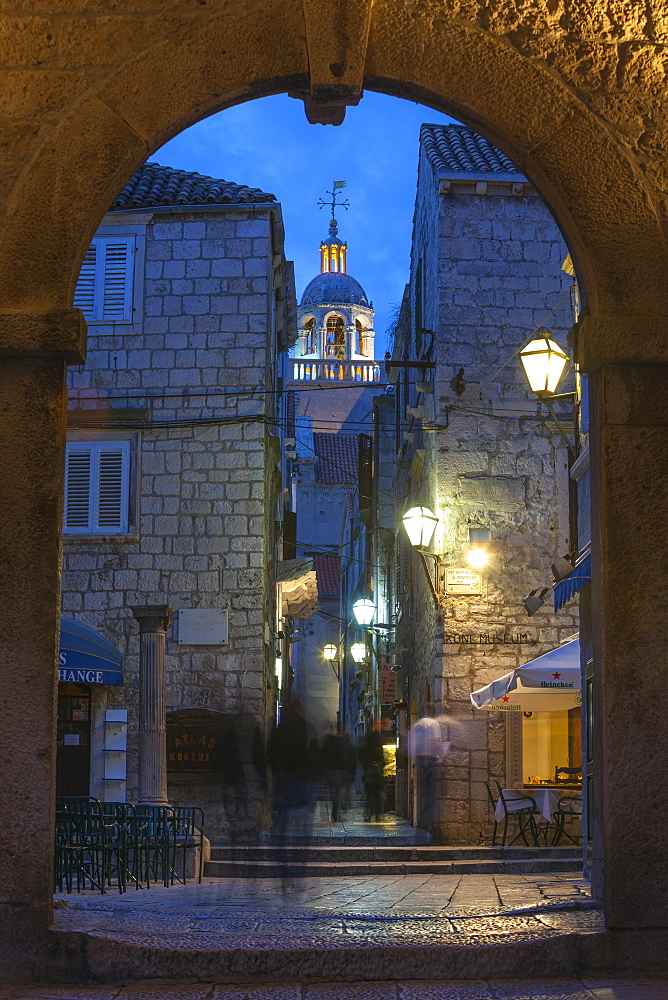 St. Marko Bell Tower and Land Gate illuminated at dusk, Korcula Town, Korcula, Dalmatia, Croatia, Europe