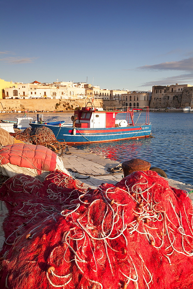 Fishing boats and fishing net at the port, old town, Gallipoli, Lecce province, Salentine Peninsula, Puglia, Italy, Mediterranean, Europe