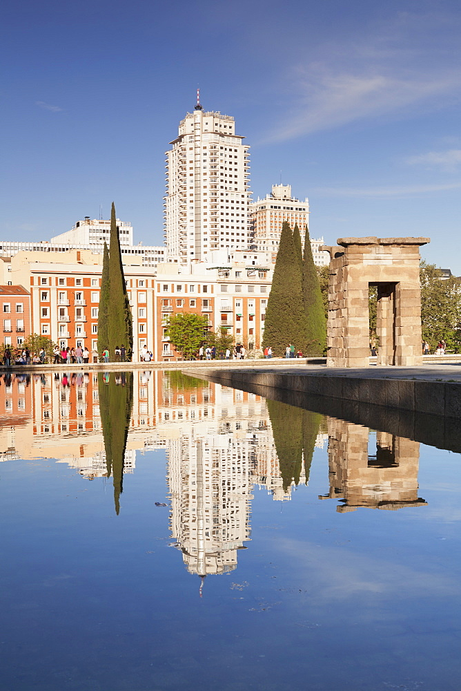 Temple of Debod (Templo de Debod), Parque del Oeste, Edificio Espana tower in the background, Madrid, Spain