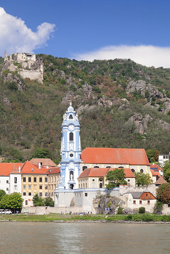 View over Danube River to Collegiate church and castle ruins, Durnstein, Wachau, Lower Austria, Europe