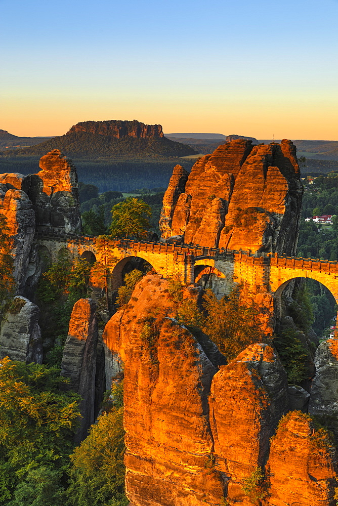 Bastei Bridge at sunrise, Lilienstein Mountain, Elbsandstein Mountains, Saxony, Germany
