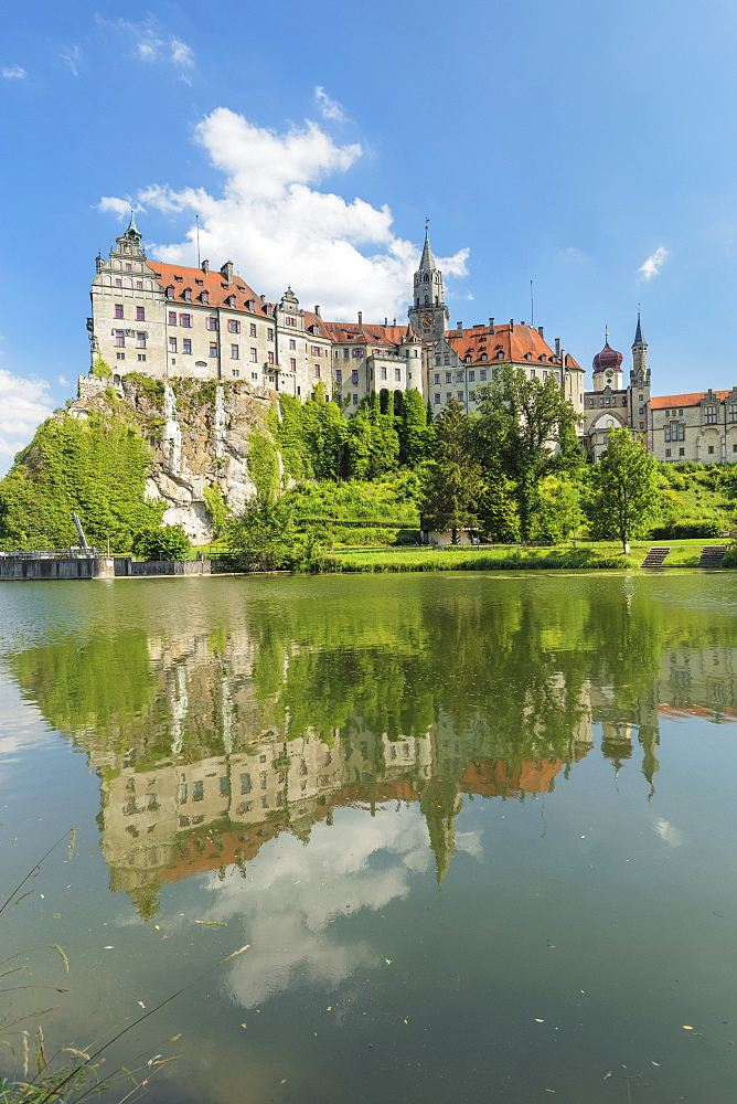 Sigmaringen Castle reflecting in Danube river, Upper Danube Valley, Swabian Jura, Baden-Wuerttemberg, Germany