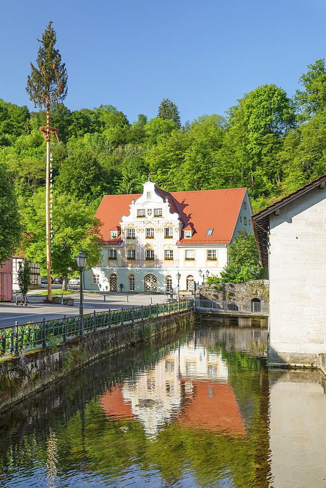 Town hall reflecting in Brenz River, Koenigsbronn, Swabian Jura, Baden-Wuerttemberg, Germany