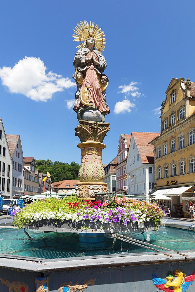 Mondsichelmadonna sculpture, Marienbrunnen fountain at market sqaure, Schwaebisch-Gmuend, Baden-Wuerttemberg, Germany