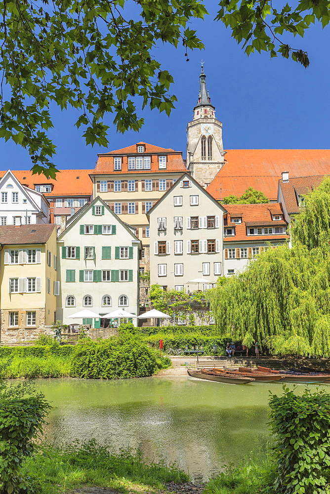 Old town with Stiftskirche church reflecting in Neckar river, Tuebingen, Baden-Wuerttemberg, Germany