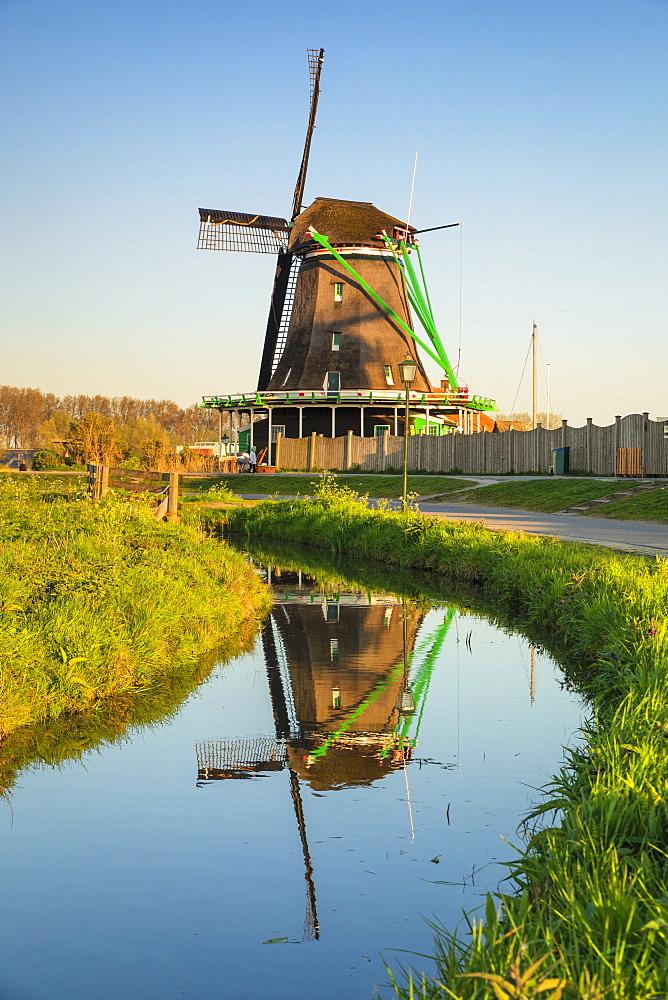 Windmill reflecting in a river, open-air museum, Zaanse Schans, Zaandam, North Holland, Netherlands, Europe - 1160-4321