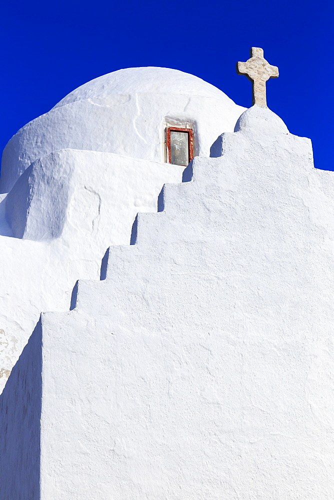 Whitewashed Panagia Paraportiani, Mykonos most famous church, under a blue sky, Mykonos Town (Chora), Mykonos, Cyclades, Greece