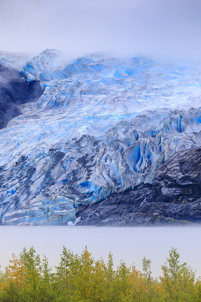 Bright blue ice of Mendenhall Glacier flowing from Juneau Ice Field, mist on Mendenhall Lake, Juneau, Alaska, United States of America, North America