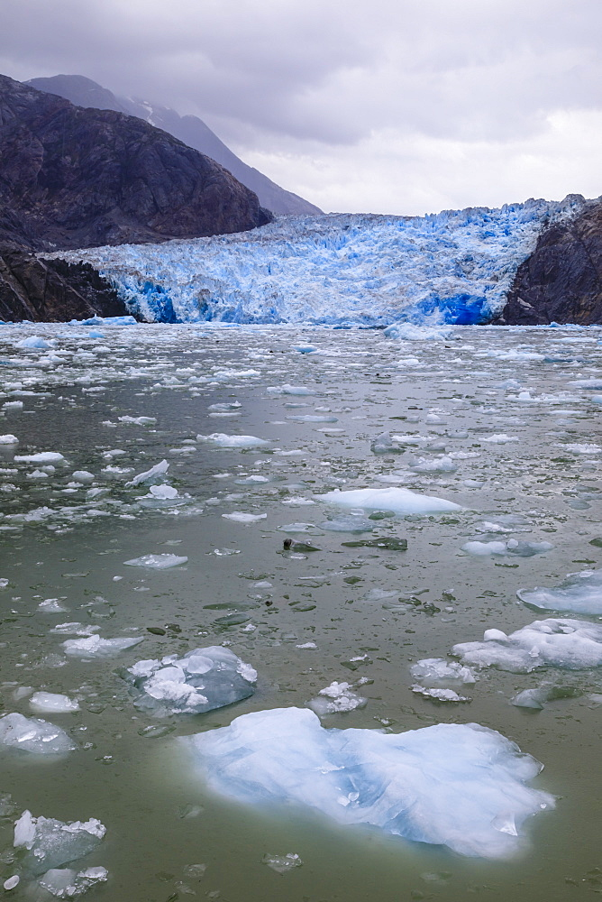 Ice pack and blue ice face of South Sawyer Glacier, mountain backdrop, Stikine Icefield, Tracy Arm Fjord, Alaska, USA - 1167-1649