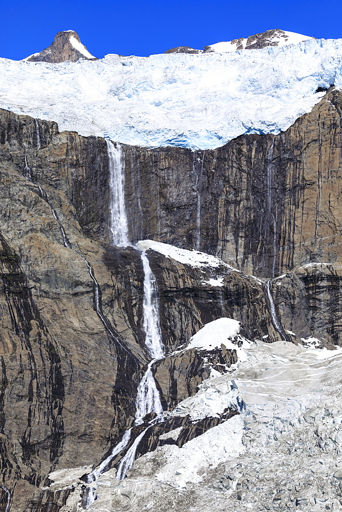 Glacier and waterfall, South Skjoldungen Fjord, Skjoldungen Island, glorious weather, remote South East Greenland