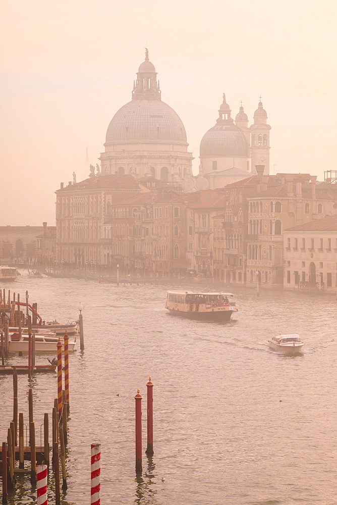 Beautiful Grand Canal, winter fog, morning golden light, Santa Maria della Salute, Venice, UNESCO World Heritage Site, Veneto, Italy, Europe