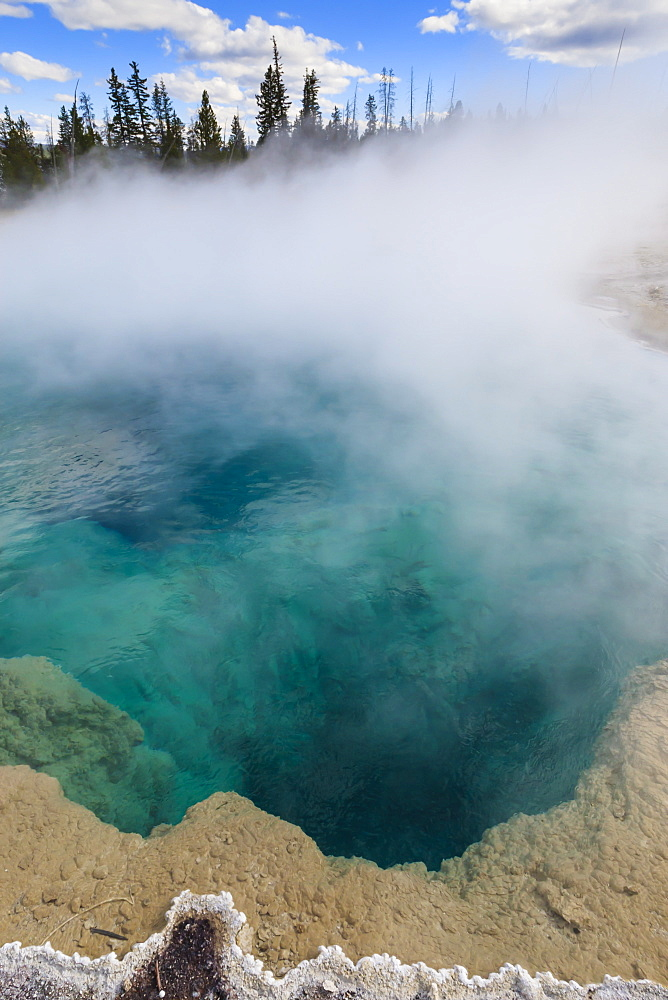 Steam and turquoise depths at Black Pool, dawn, West Thumb Geyser Basin, Yellowstone National Park, UNESCO World Heritage Site, Wyoming, United States of America, North America