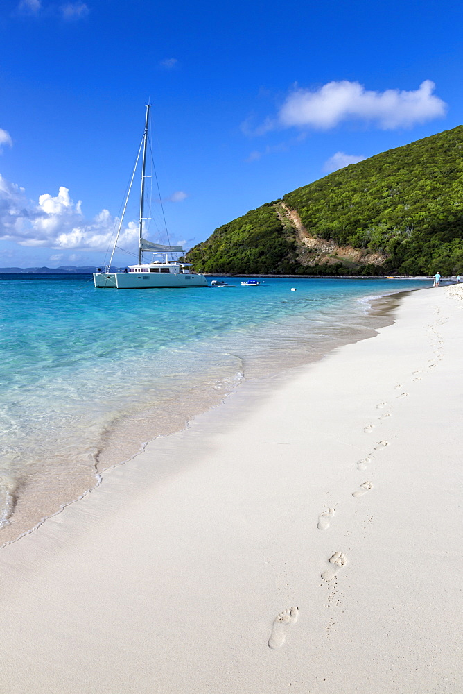 Footprints in white sand on shoreline with yacht, White Bay, Jost Van Dyke, British Virgin Islands, West Indies, Caribbean, Central America