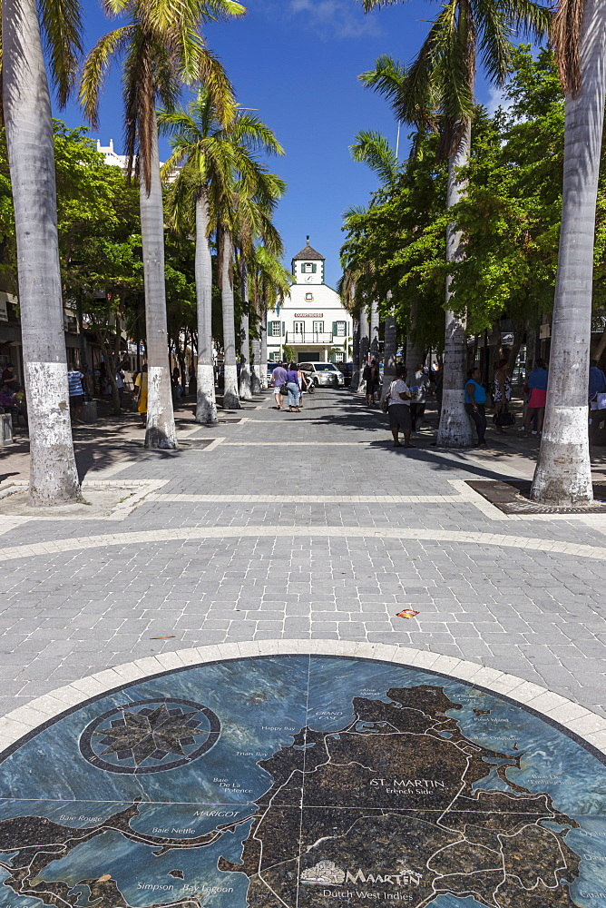 View along palm lined avenue to courthouse with pavement map of the island, Philipsburg, St. Maarten (St. Martin), West Indies, Caribbean, Central America