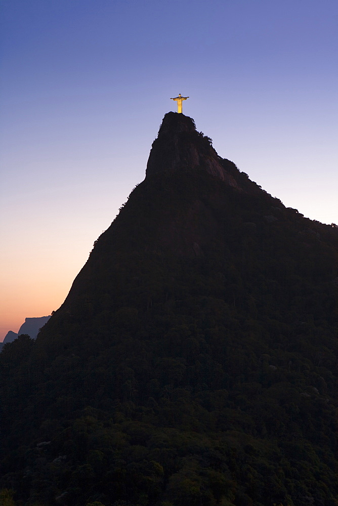 Christ the Redeemer statue on the summit of Corcovado Hill in Tijuca National Park, part of the World Heritage Rio landscape, Rio de Janeiro, Brazil, South America