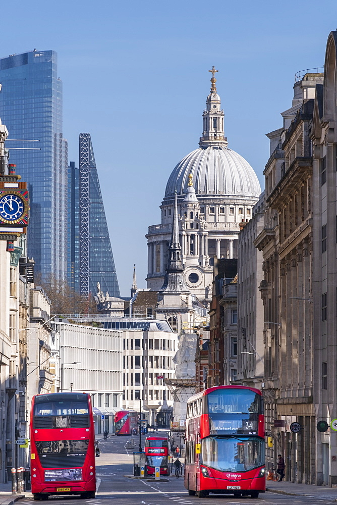 Red double-decker buses on Fleet Street with the dome of St. Paul's Cathedral and skyscrapers in the financial district of City of London, London, England, United Kingdom, Europe