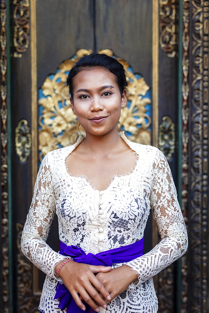 A beautiful local woman wearing traditional Balinese temple dress, Bali, Indonesia, Southeast Asia, Asia