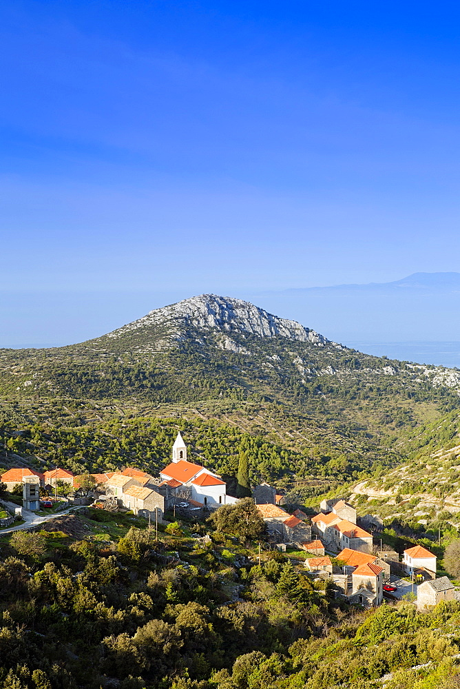 Europe, Eastern Europe, Croatia, Dalmatia, Hvar Island. Velo Grablje village and mountains against the Adriatic Sea