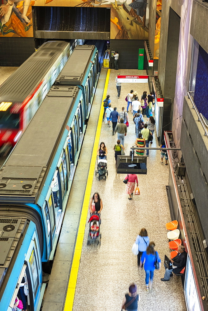 A subway station showing a train and commuter platform on the Metro de Santiago rapid transit system station, Santiago, Chile, South America