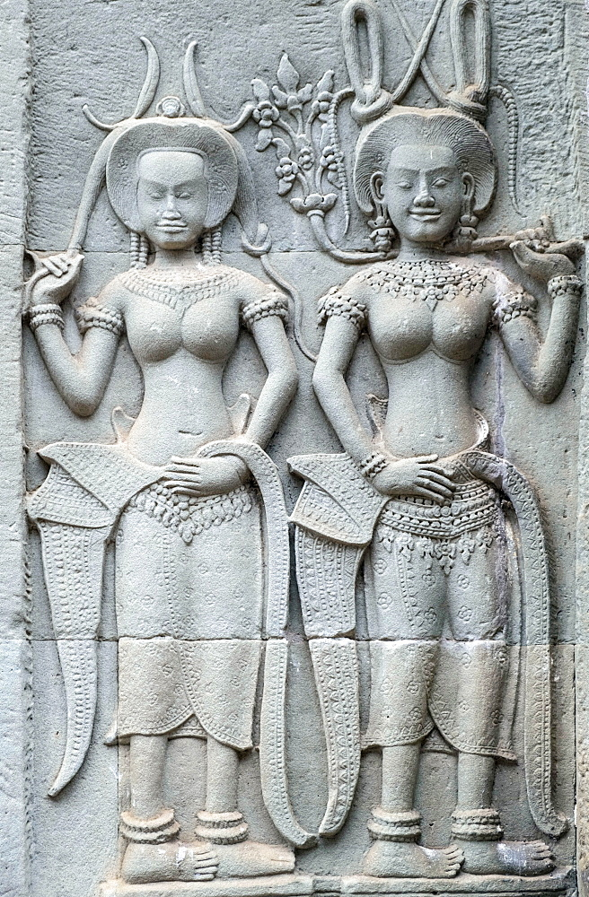 Carvings of Apsaras (a spirit of the clouds and waters in Hindu and Buddhist culture) on the exterior of a temple at Angkor - 1176-914