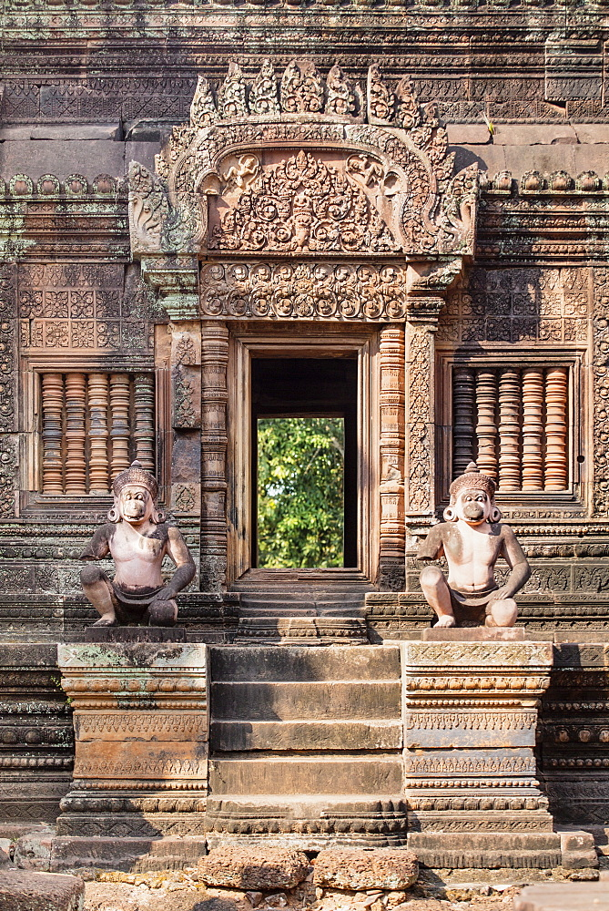 Detailed carving on the facade of a temple at Banteay Srei in Angkor - 1176-942