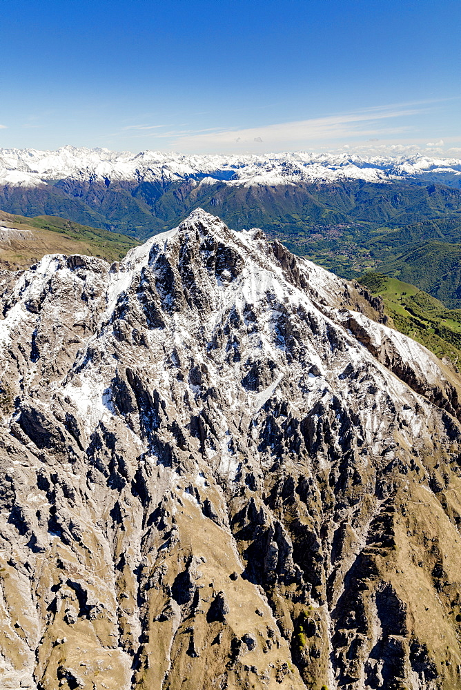 Aerial view of the snowy ridges of the Grignetta mountain in spring, Lecco Province, Lombardy, Italy, Europe