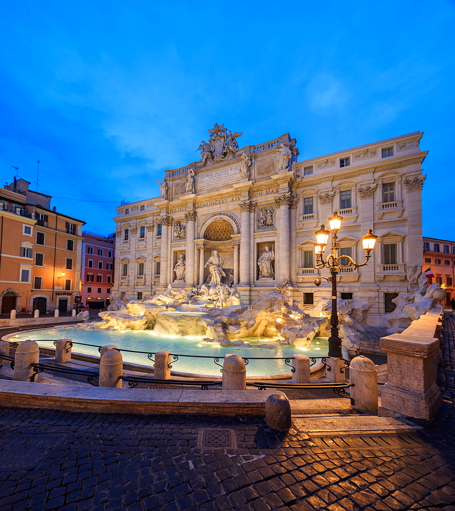 Panorama of Trevi Fountain illuminated by street lamps and the lights at dusk, Rome, Lazio, Italy, Europe