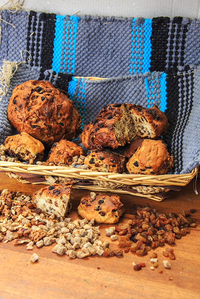 Basket of Bisciola, typical Italian bread made with walnuts, raisins and figs from Valtellina, Lombardy, Italy, Europe