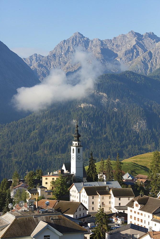 Blue sky on the alpine village of Ftan surrounded by rocky peaks, Inn district, Canton of Graubunden, Engadine, Switzerland, Europe