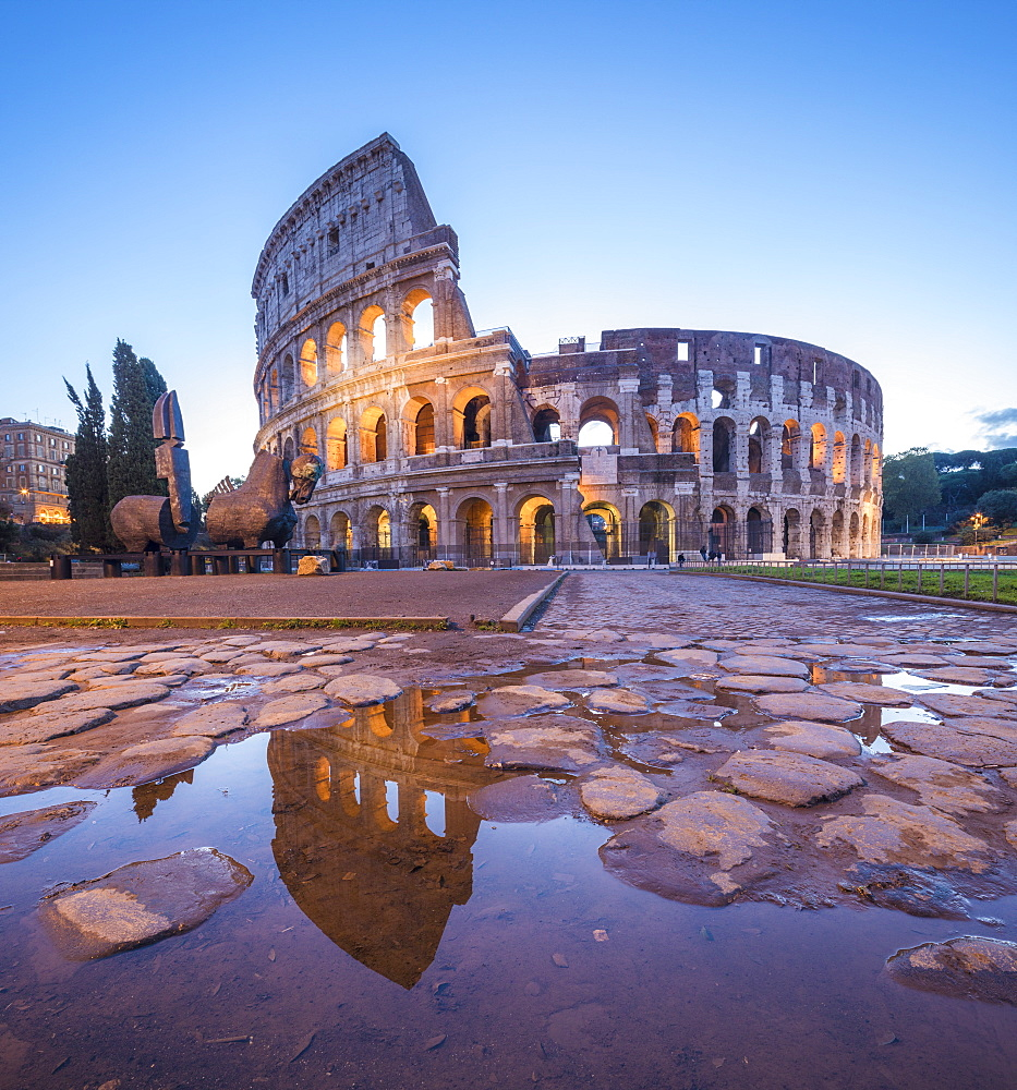 The Colosseum (Flavian Amphitheatre), UNESCO World Heritage Site, reflected in a puddle at dusk, Rome, Lazio, Italy, Europe