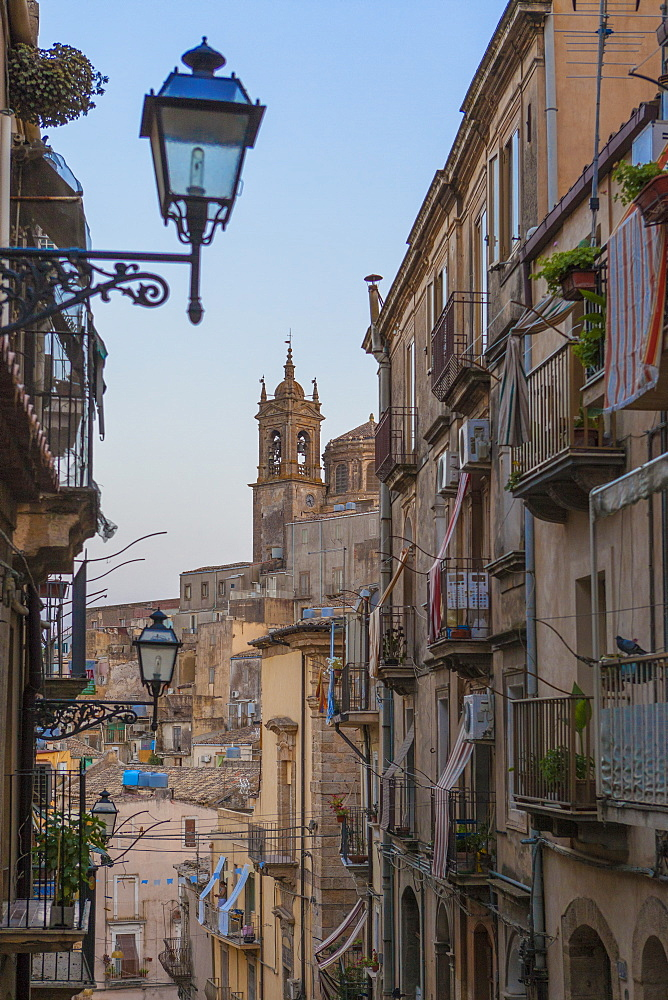 Street lanterns and houses in the typical alleys of the old town Caltagirone province of Catania Sicily Italy Europe