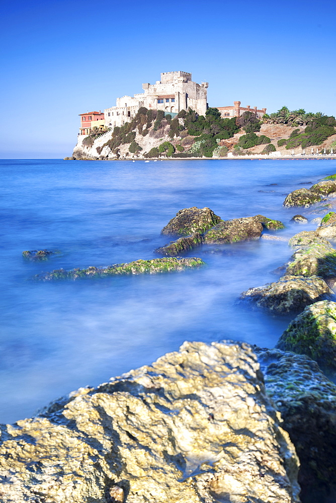 Sunrise on turquoise sea frames the medieval Falconara Castle, Butera, Province of Caltanissetta, Sicily, Italy, Mediterranean, Europe