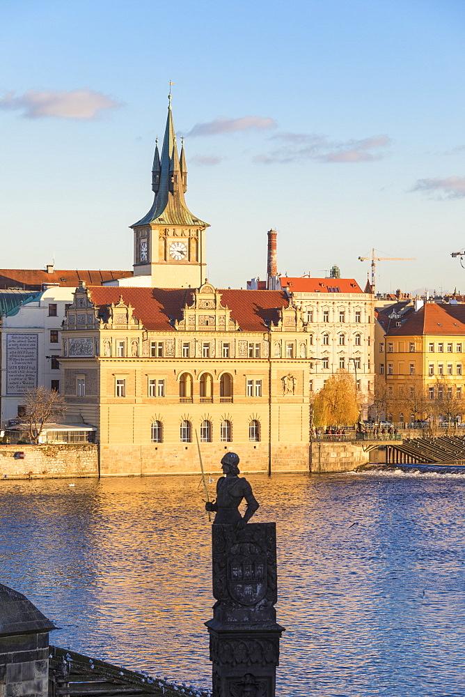 View of the Vltava River and ancient clock tower, Prague, Czech Republic, Europe
