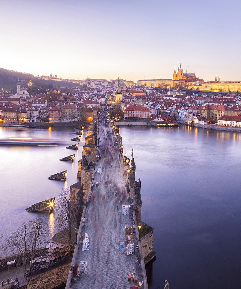 Vltava River and by Charles Bridge at sunset, UNESCO World Heritage Site, Prague, Czech Republic, Europe
