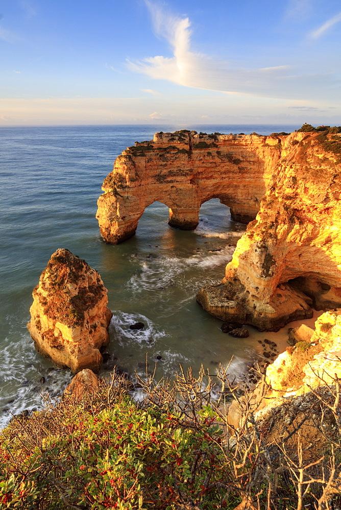 Sunrise on cliffs framed by turquoise water of the ocean Praia da Marinha Caramujeira Lagoa Municipality Algarve Portugal Europe - 1179-1920