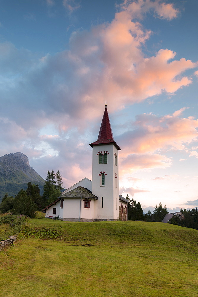Clouds at sunset on Chiesa Bianca, Maloja, Bregaglia Valley, Engadine, Canton of Graubunden, Swiss Alps, Switzerland, Europe