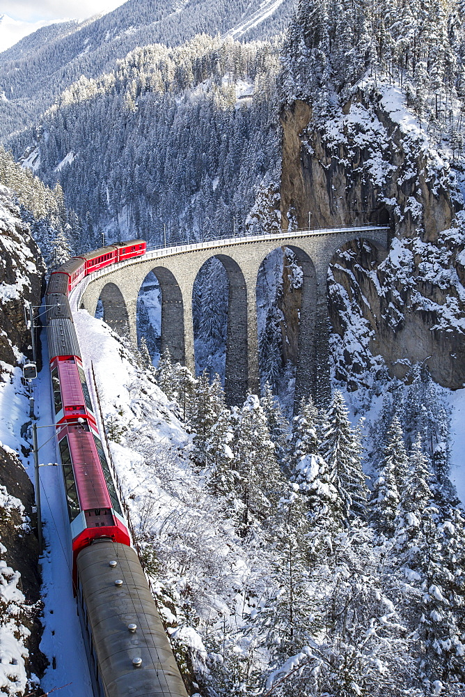 The red train of the Albula-Bernina Express Railway, UNESCO World Heritage on the famous Landwasser Viaduct, Switzerland, Europe
