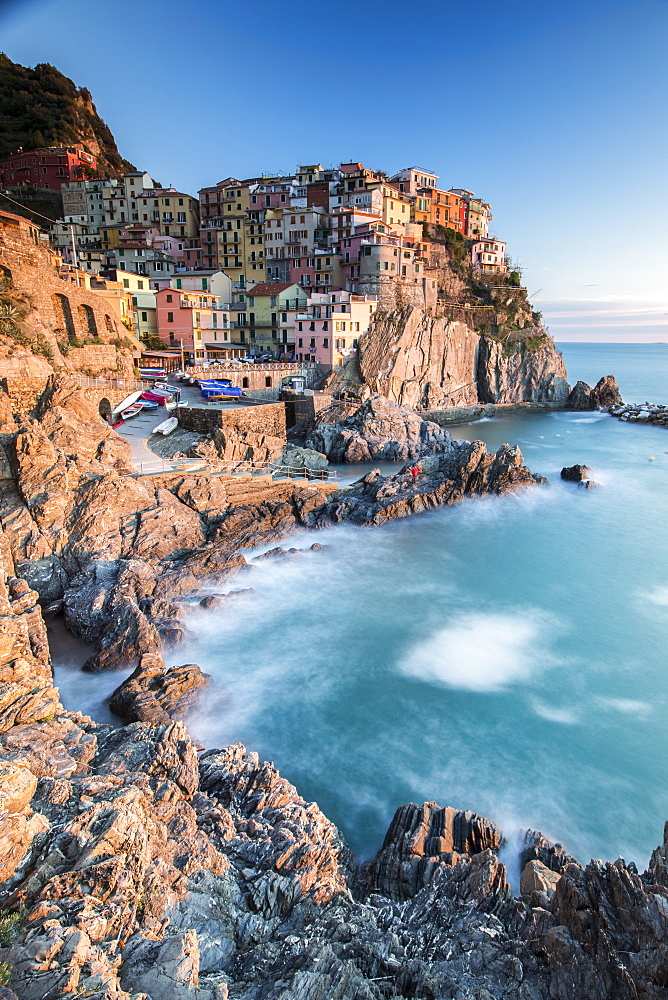 Sunset in the village of Manarola with its pastel coloured houses and its cosy dock, Cinque Terre National Park, UNESCO World Heritage Site, Liguria, Italy, Europe